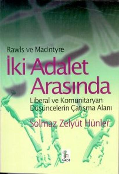 İki Adalet Arasında Liberal ve Komunitaryan Düşüncelerin Çatışma Alanı.pdf
